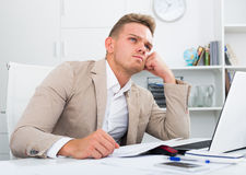 Tired man working in office Royalty Free Stock Photo