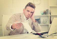 Tired man working in office Stock Images