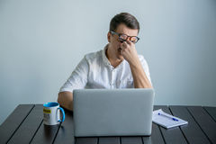 Tired man working in the office Stock Image