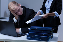 Tired man working overtime Royalty Free Stock Photography