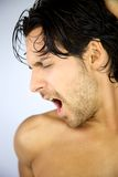 Tired man yawning Stock Images