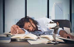 Tired manager needs caffeine Royalty Free Stock Photo