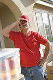 Tired Mature Delivery Man Stock Image