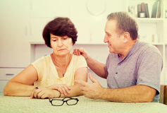 Tired mature woman having issues with her husband Stock Images