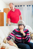 Tired mature woman listening to angry husband Stock Images