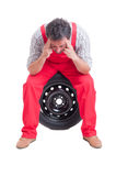 Tired mechanic massaging his temples Royalty Free Stock Photos