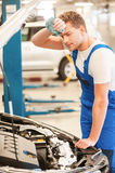 Tired mechanic. Stock Image