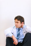 Tired medical doctor sitting on floor Stock Photo