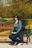 Tired Middle age woman resting on bench Stock Photos