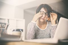 Tired middle age woman rubbing eyes stock photos