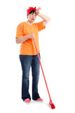 Tired middle-aged woman with dotted broom Stock Images