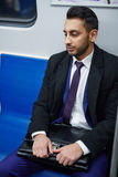 Tired Middle-Eastern Businessman on Subway train Stock Photos