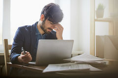 Tired Middle Eastern Businessman at Workplace Royalty Free Stock Photo