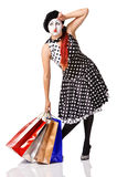 Tired mime in spotty dress holding shopping bags Royalty Free Stock Photo