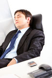 Tired modern businessman sleeping on armchair Stock Photo