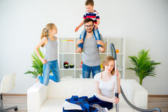 Tired mother vacuum cleaning Stock Photography