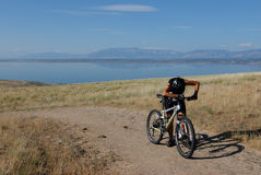 Tired mountain biker. Female biker out of breath Royalty Free Stock Image