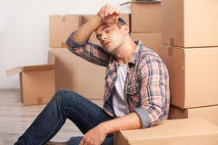 Tired of moving boxes. Stock Image