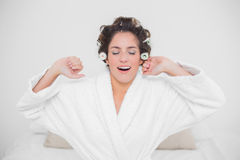 Tired natural brunette closing her eyes Royalty Free Stock Photo