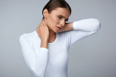 Tired Neck. Beautiful Woman Suffering From Pain, Painful Feeling. Tired Neck. Beautiful Young Woman Suffering From Neck Pain. Attractive Female Feeling Tired Royalty Free Stock Image