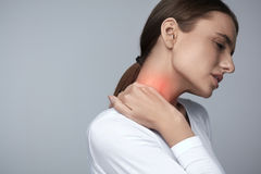 Tired Neck. Beautiful Woman Suffering From Pain, Painful Feeling Royalty Free Stock Images