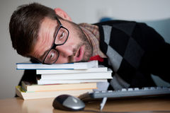 A tired nerd falling asleep Royalty Free Stock Images