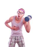 Tired nerd trains with dumbbell Stock Photography