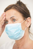 Tired nurse with mask over face Royalty Free Stock Image