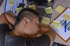 Tired office man falling asleep on laptop and sticky notes. Tired office man falling asleep on laptop and many sticky notes stock photos