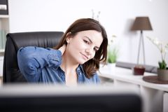 Tired Office Woman Holding Back of her Neck Royalty Free Stock Photo