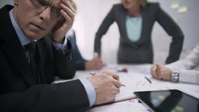 Tired office worker feeling scared, suffering at meeting with terror lady boss. Stock footage stock video