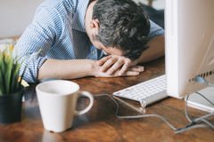 Tired office worker sleeping Stock Image