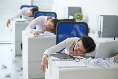 Tired office workers Stock Photos