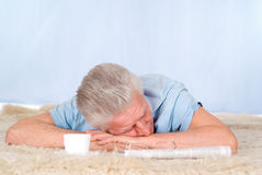 Tired old man Stock Images