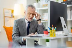 Tired old man being busy office worker and having headache stock photo