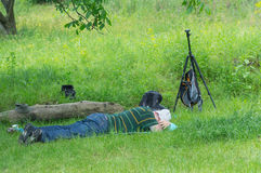 Tired outdoor photographer having rest Stock Image