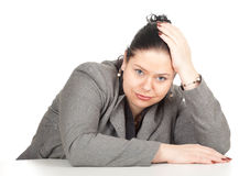Tired overweight, fat businesswoman. In grey suit, series Royalty Free Stock Photo