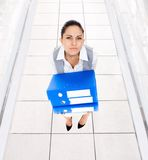 Tired overworked business woman folder stack Royalty Free Stock Photos