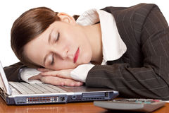 Tired overworked business woman sleeps in office Stock Image