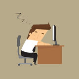 Tired overworked businessman sleeps on desk Royalty Free Stock Photos