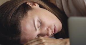 Tired overworked employee businesswoman fallen asleep at workplace.