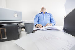 Tired and overworked office worker Royalty Free Stock Photos