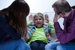 Tired parents with educational problems. With son Stock Images
