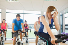 Tired people working out at spinning class Royalty Free Stock Images