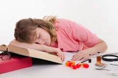 Tired pharmacist sleeping on the reference Royalty Free Stock Image