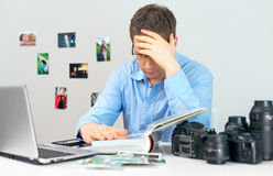 Tired photographer. Royalty Free Stock Images