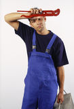 Tired plumber Royalty Free Stock Images