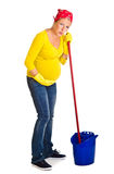 Tired pregnant woman cleaning Stock Photos