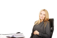 Tired pregnant woman sitting in the office Stock Photography