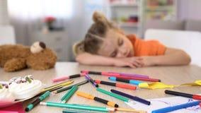 Tired preschooler sleeping at desk, boring class, elementary school education. Stock photo royalty free stock photography